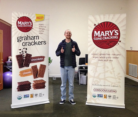 Casey From Mary's Gone Crackers with banners in retractable stands